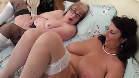 Of age grandma lesbians just about huge saggy tits make out in bed