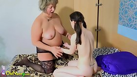Old grannie pansy plays with young teen